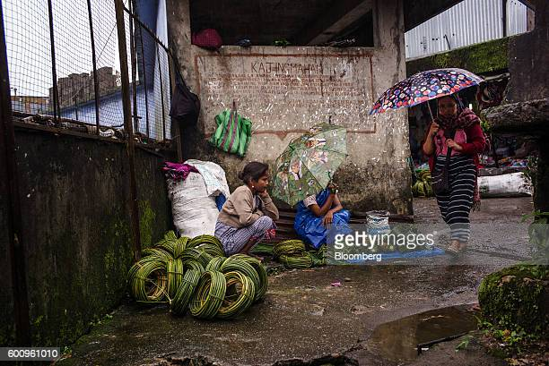 A customer walks past a vendor selling fruit at a market in Cherrapunji Meghalaya India on Saturday Aug 13 2016 Two years of deficient rainfall have...