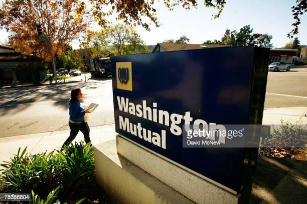 A customer walks past a Washington Mutual bank sign December 11 2007 in La Canada California The nation's biggest savings and loan Washington Mutual...