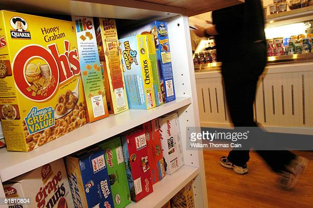 A customer walks past boxes of cereal at Cereality Cereal Bar and Cafe December 1 2004 in Philadelphia Pennsylvania Cereality sells almost any cereal...