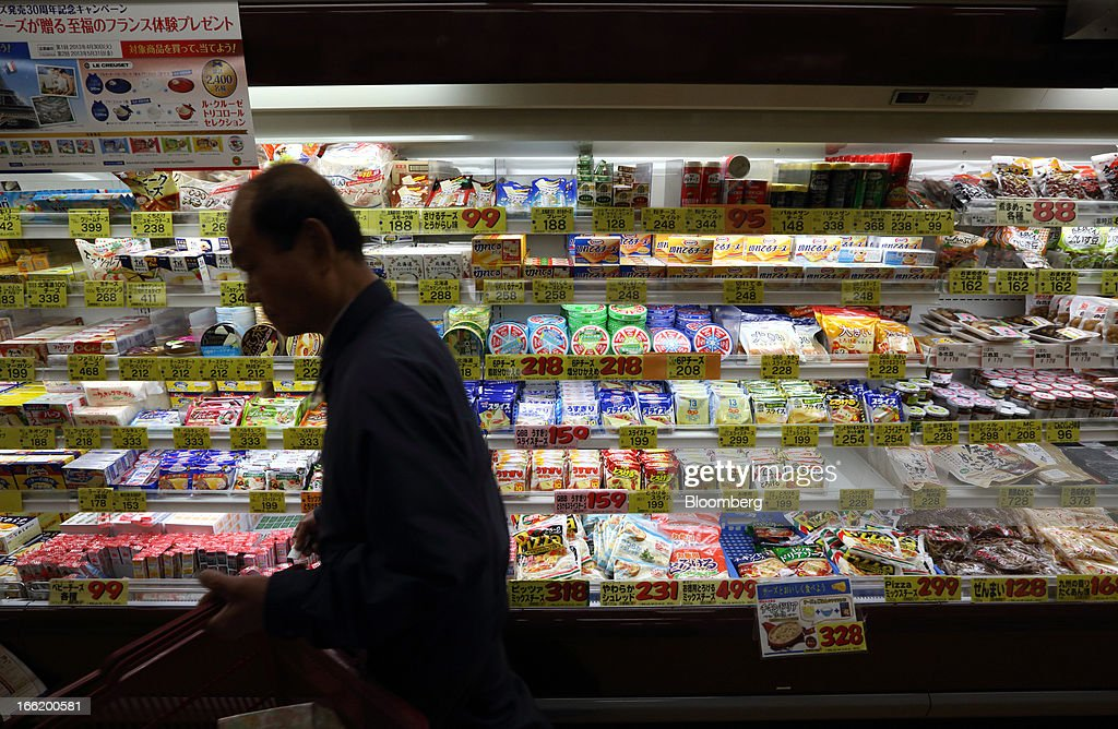A customer walks past the dairy section at a supermarket in Tokyo, Japan, on Tuesday, April 9, 2013. After Bank of Japan Governor Haruhiko Kuroda's first policy meeting as governor on April 4, the central bank set a two-year horizon for the 2 percent annual price-increase target that it adopted in January at the urging of Prime Minister Shinzo Abe. Photographer: Tomohiro Ohsumi/Bloomberg via Getty Images