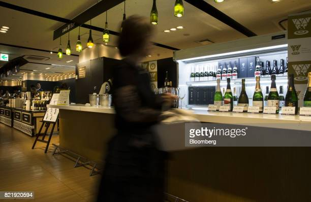 A customer walks past the Japan Awasake Association booth during a Sake Marche event at the Isetan Shinjuku department store operated by Isetan...
