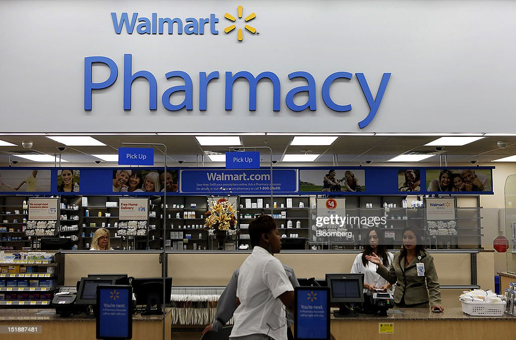 A customer walks past the pharmacy during the grand opening of a new Wal-Mart Stores Inc. location in Torrance, California, U.S., on Wednesday, Sept. 12, 2012. The Wal-Mart store, which was the first location to open in Los Angeles County since 2006, was built inside of a former Mervyn's clothing location. Photographer: Patrick Fallon/Bloomberg via Getty Images