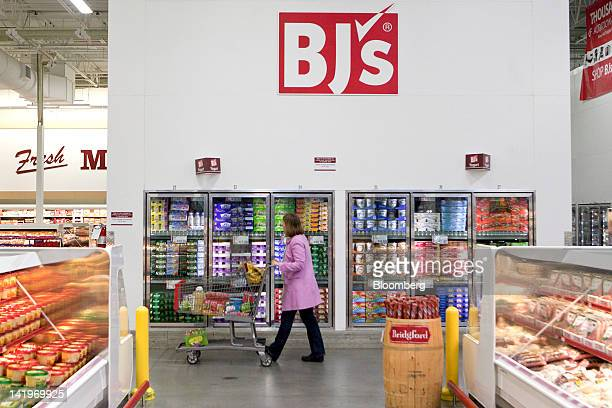 A customer walks through a BJ's Wholesale Club Inc store in Falls Church Virginia US on Tuesday March 27 2012 The US Bureau of Economic Analysis is...
