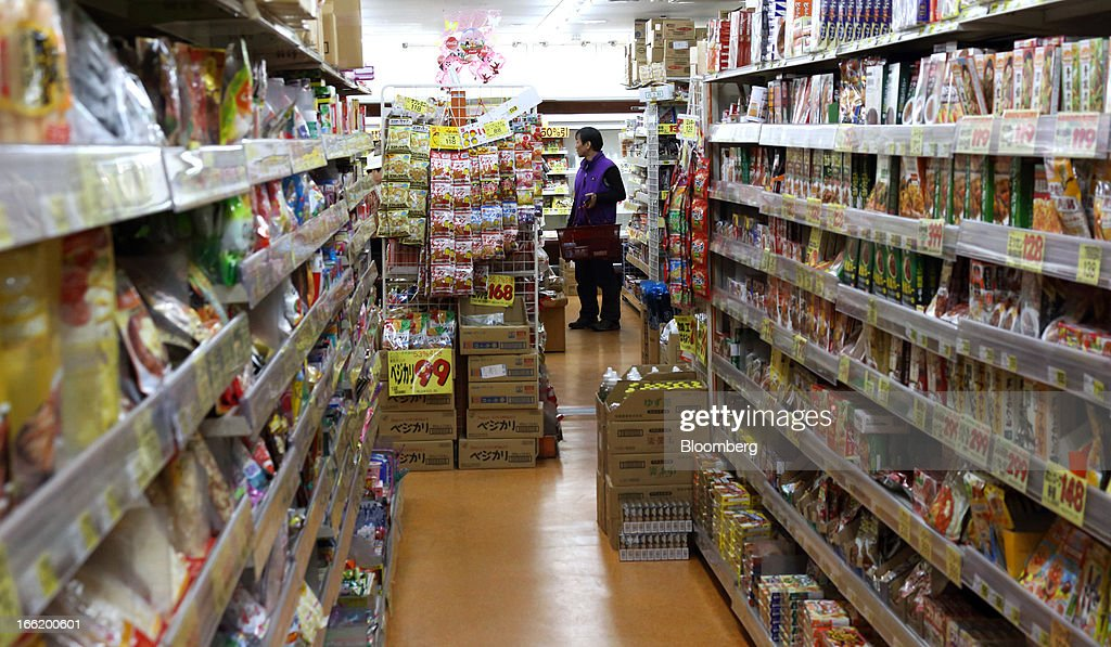 A customer walks through a supermarket in Tokyo, Japan, on Tuesday, April 9, 2013. After Bank of Japan Governor Haruhiko Kuroda's first policy meeting as governor on April 4, the central bank set a two-year horizon for the 2 percent annual price-increase target that it adopted in January at the urging of Prime Minister Shinzo Abe. Photographer: Tomohiro Ohsumi/Bloomberg via Getty Images