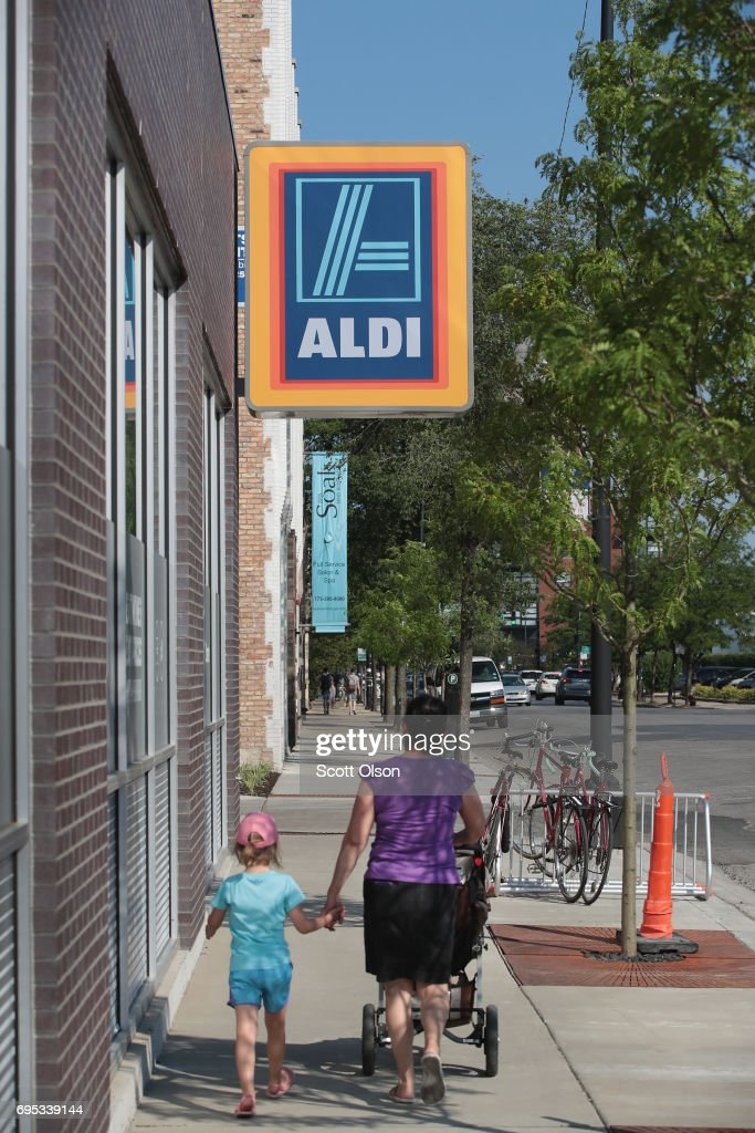 A customer walks to an Aldi grocery store on June 12, 2017 in Chicago, Illinois. Aldi has announced plans to open 900 new stores in the United States in the next five years. The $3.4 billion capital investment would create 25,000 jobs and make the grocery chain the third largest in the nation behind Wal-Mart and Kroger.