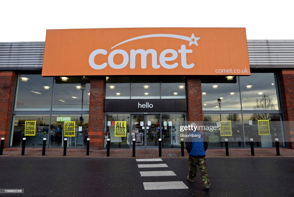 A customer walks towards the entrance of a Comet electronics store displaying 'Store Closing Down' signs in its window display, in Slough, U.K., on Friday, Nov. 23, 2012. Comet, a U.K. electronics chain, appointed Deloitte LLP as insolvency administrator, less than a year after being bought by private-equity firm OpCapita LLP. Photographer: Chris Ratcliffe/Bloomberg via Getty Images