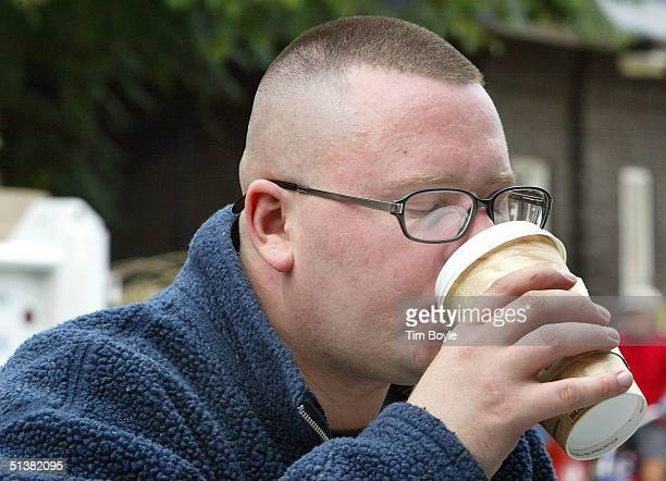 Customer Walter Schultz takes a drink of his coffee while sitting outside the Cafe Express coffee house October 1 2004 in Evanston Illinois In a...