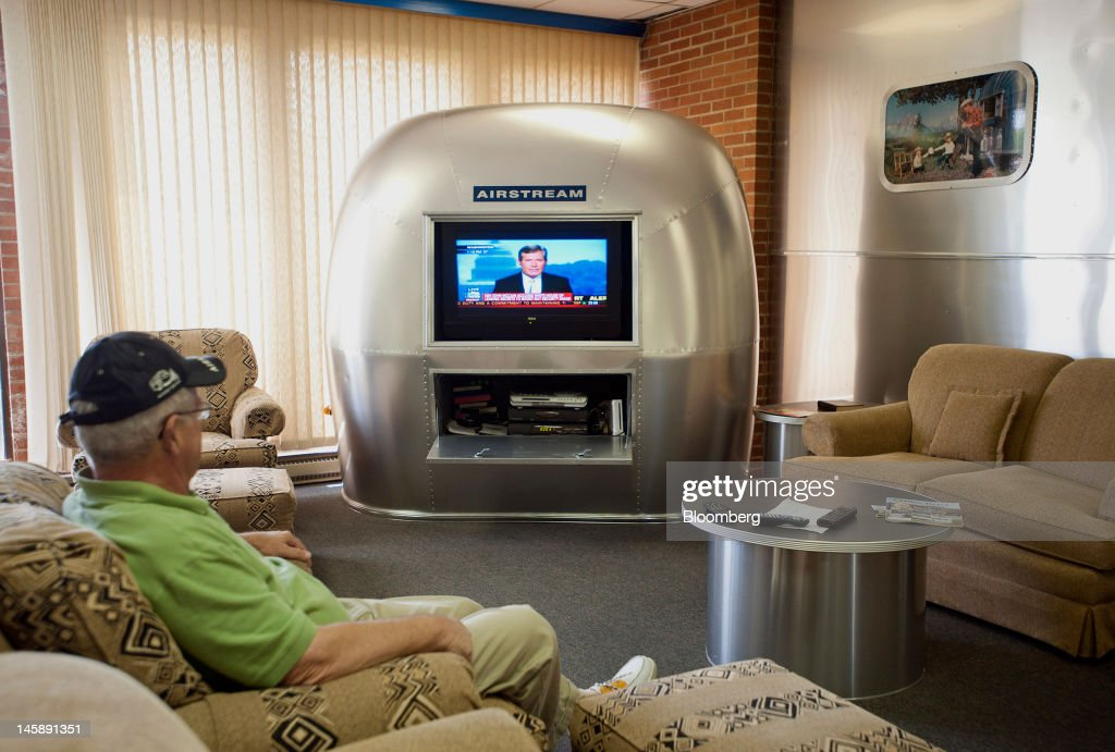 A customer watches a TV embedded in the rear section of an Airstream Inc. trailer in the service center of the company's manufacturing facility in Jackson Center, Ohio, U.S., on Wednesday, June 6, 2012. The U.S. Federal Reserve is scheduled to release industrial production data on June 15. Photographer: Ty Wright/Bloomberg via Getty Images