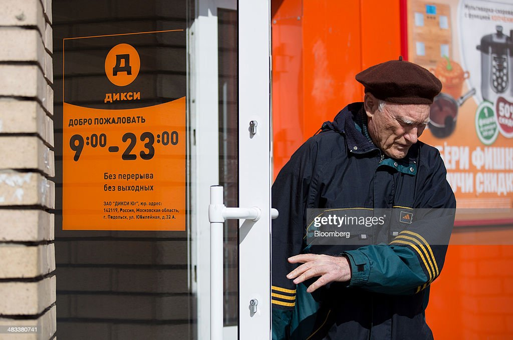 A customer wearing a beret exits a Dixy supermarket operated by OAO Dixy Group in Moscow, Russia, on Tuesday, April 8, 2014. Suppliers suffering from ruble depreciation this quarter are urging retailers to increase prices. Photographer: Andrey Rudakov/Bloomberg via Getty Images