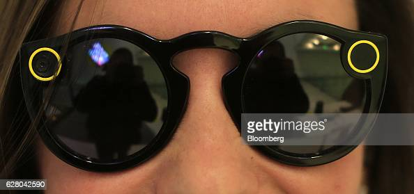 A customer wears Snapchat Spectacles by Snap Inc inside the company's popup store in New York US on Monday Dec 5 2016 Snap Inc has confidentially...