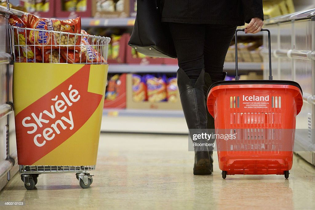 A customer wheels a branded shopping basket along an aisle inside an Iceland Foods Ltd. store in Prague, Czech Republic, on Friday, Jan. 3. 2014. The Czech Republic's 2013 budget deficit of 80.9 billion koruna ($4.01 billion) beat the 100 billion-koruna target after the government cut spending, the Finance Ministry said. Photographer: Martin Divisek/Bloomberg via Getty Images