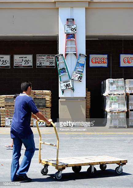 A customer wheels a cart in the parking lot of a Home Depot store on August 17 2010 in Los Angeles California Atlantabased Home Depot Inc's fiscal...