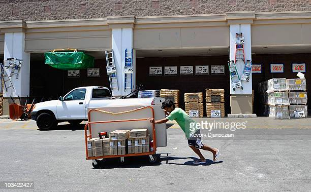 A customer wheels his goods in the parking lot of a Home Depot store on August 17 2010 in Los Angeles California Atlantabased Home Depot Inc's fiscal...