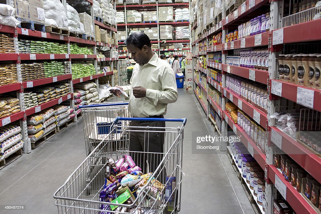 A customer with a shopping cart checks his shopping list at a Walmart India Pvt. Best Price Modern Wholesale store in the town of Zirakpur on the outskirts of Chandigarh, Punjab, India, on Tuesday, June 10, 2014. India's consumer price index (CPI) figures and wholesale price inflation figures for May are scheduled for release on June 12 and 16 respectively. Photographer: Udit Kulshrestha/Bloomberg via Getty Images