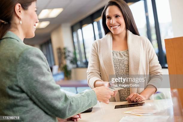 Customer withdrawing money at bank counter
