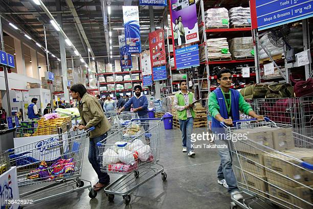 Customers and workers at Best Price a whole sale store owned jointly by Walmart and Bharti Enterprise in Jalandhar India on November 30 2011 Indian...