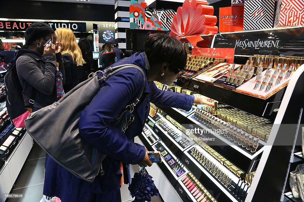 Customers apply makeup and shop inside Sephora Brooklyn during the Sephora Brooklyn Grand Opening on November 1, 2013 in New York City.