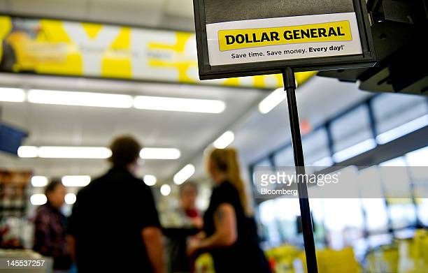 Customers are helped at a Dollar General Corp store in Creve Coeur Illinois US on Thursday May 31 2012 US consumer spending rose in April a sign that...