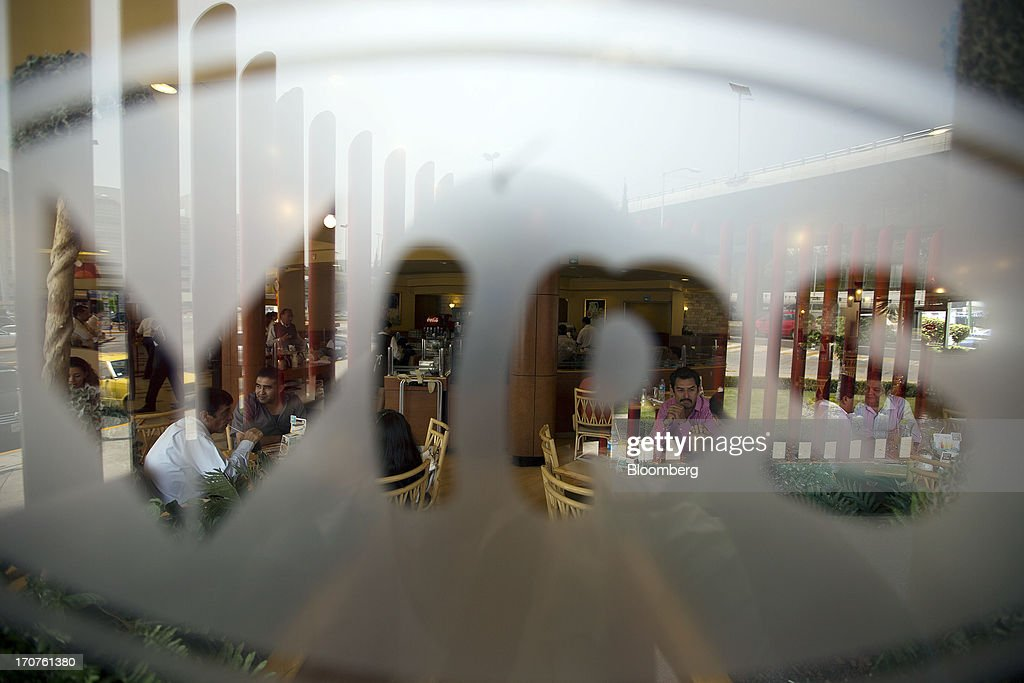 Customers are seen dining at a Vips restaurant through the company logo on a window in the El Toreo neighborhood of Mexico City, Mexico, on Monday, June 17, 2013. Wal-Mart de Mexico SAB de CV, known as Walmex, is considering offers to sell its restaurant division, which includes the Vips, El Porton, Ragazzi and La Finca brands. Photographer: Susana Gonzalez/Bloomberg via Getty Images