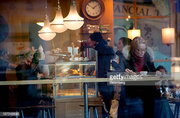Customers are seen in a coffee shop in Oslo Norway on Wednesday Dec 1 2010 Norwegian manufacturing expanded last month at the fastest pace since...