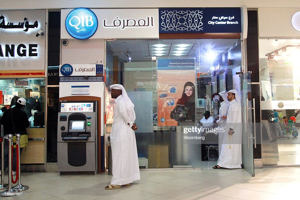 Customers are seen inside a Qatar Islamic Bank (QIB) branch in Doha, Qatar, on Thursday, Nov. 22, 2012. Qatar Telecom QSC, the country's biggest company by revenue, is seeking a syndicated loan for about $1 billion to refinance existing debt, according to a person with direct knowledge of the deal. Photographer: Gabriela Maj/Bloomberg via Getty Images