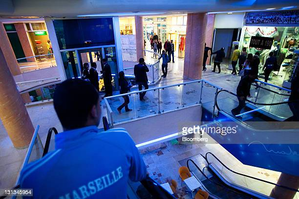 Customers are seen inside a shopping mall on Avenue Bourguiba in Tunis Tunisia on Wednesday Nov 2 2011 Tunisia's government expects economic growth...