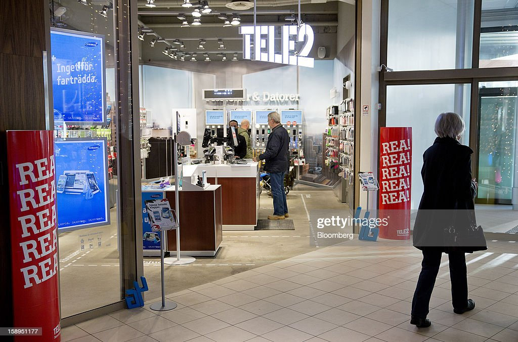 Customers are seen inside a Tele2 AB store at the Farsta Centrum shopping center in Stockholm, Sweden, on Friday, Jan. 4, 2013. OAO Rostelecom's largest owner after the Russian state, Konstantin Malofeev, is urging the country's dominant fixed-line operator to buy the local unit of Sweden's Tele2 AB to form a fourth nationwide wireless carrier. Photographer: Casper Hedberg/Bloomberg via Getty Images