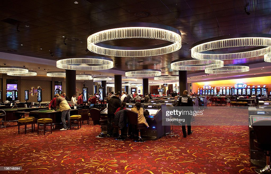 Customers are seen on the gaming floor at Aspers Casino at Westfield Stratford City Mall in London, U.K. on Wednesday, Jan. 11, 2012. Westfield Group agreed to sell its 75 percent interest in the Broadmarsh shopping center to Capital Shopping Centres for 55 million pounds. Photographer: Simon Dawson/Bloomberg via Getty Images