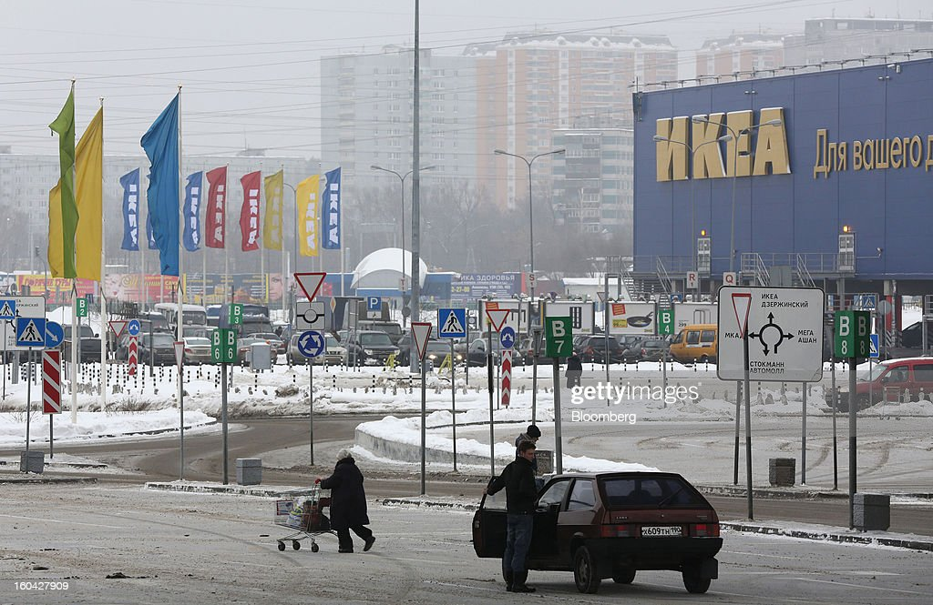 Customers are seen outside the Ikea Group store at the MEGA Belaya Dacha shopping complex, constructed by the real estate development arm of Inter Ikea Systems BV and one of Europe's largest malls, in Moscow, Russia, on Thursday, Jan. 31, 2013. Russian shopping-mall construction may climb to a record this year as retailers take advantage of rising sales by moving into bigger, more modern buildings, Cushman & Wakefield Inc. said. Photographer: Andrey Rudakov/Bloomberg via Getty Images