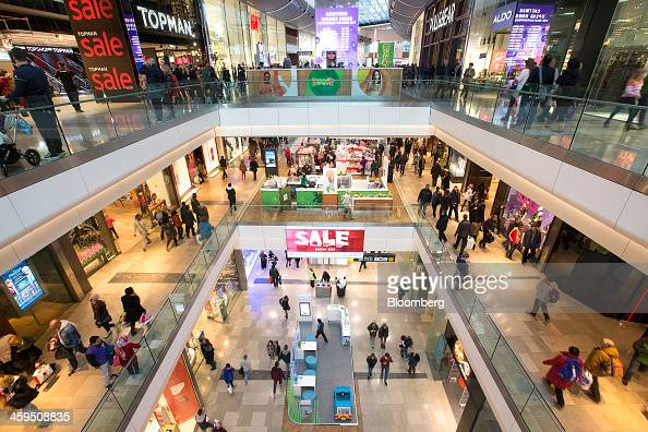 Customers are seen shopping for discounted goods as they browse stores at the Westfield Stratford City mall during the Christmas sales in London UK...