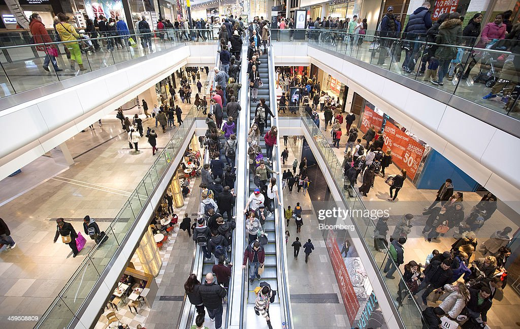 Customers are seen traveling on escalators as they shop for discounted goods in the Christmas sales at the Westfield Stratford City mall in London UK...