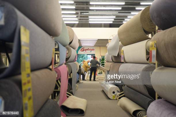 Customers are served in a branch of the Carpet Right store on June 27 2017 in south London England The national carpeting chain has announced that it...