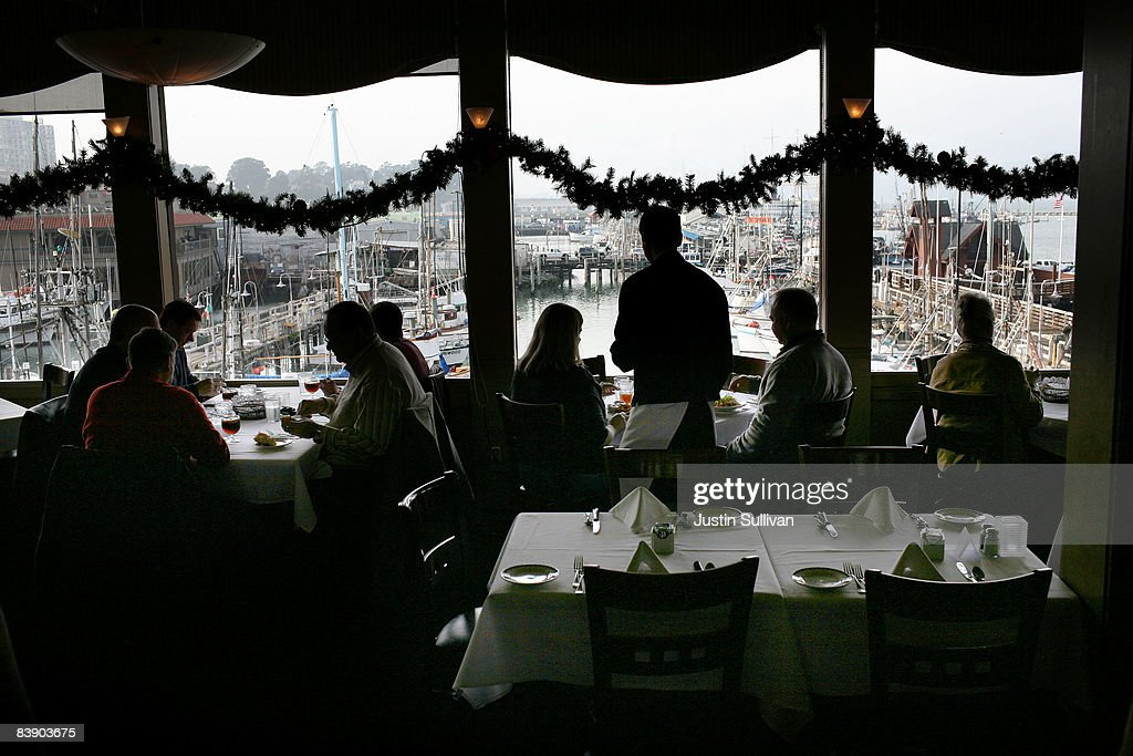 Customers are served lunch at Alioto's Seafood Restaurant December 3, 2008 in San Francisco, California. A report by The Institute for Supply Management says that its services sector index dropped in November to 37.3, down from 44.4 in October as the service industry struggles through the weak economy.