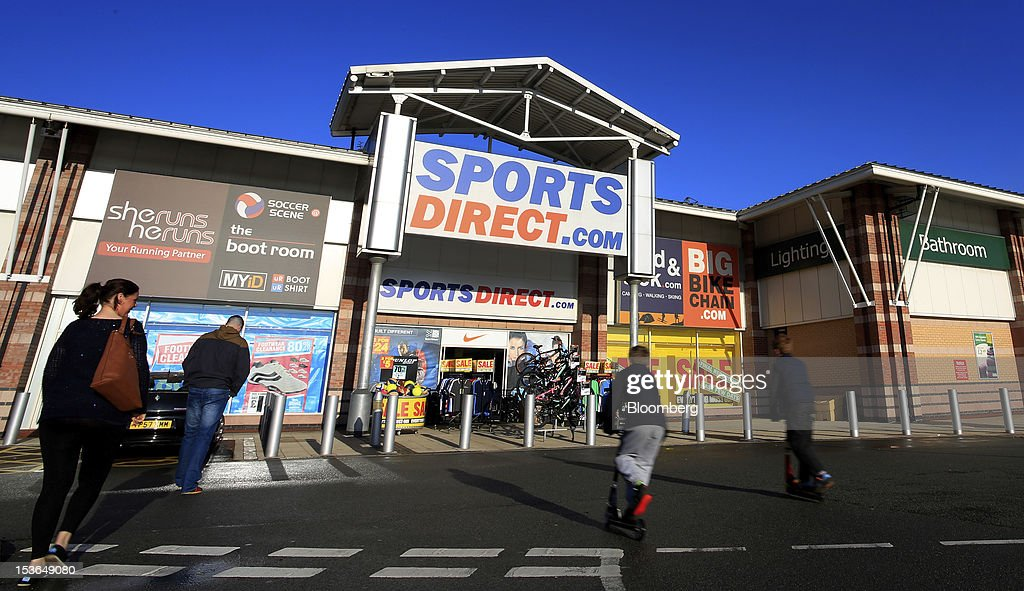 Customers arrive at a Sports Direct International Plc store in Urmston, U.K., on Saturday, Oct. 6, 2012. JJB Sports Plc, a U.K. sporting goods retailer, will close most of its stores with the remaining 20 being acquired by competitor Sports Direct International Plc, according to a statement from KPMG LLP, which was appointed as administrator to the Wigan, England-based company. Photographer: Paul Thomas/Bloomberg via Getty Images