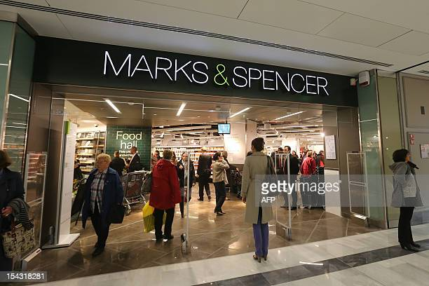 Customers arrive to do some shopping at a Marks Spencer store on its opening day on October 18 2012 at the So Ouest shopping center in...