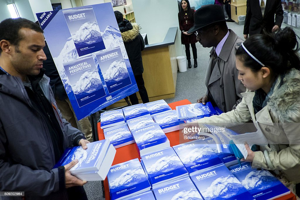 Customers arrive to purchase copies of U.S. President Barack Obama's Fiscal Year 2017 Budget at the Government Publishing Office bookstore in Washington, D.C., U.S., on Tuesday, Feb. 9, 2016. Obama will send a fiscal 2017 budget of about $4 trillion to the Republican-controlled Congress on Tuesday representing his aspirations for the future of the U.S. Photographer: Pete Marovich/Bloomberg via Getty Images