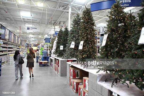 Customers at a Lowe's home improvement store walk by a display of artificial Christmas trees on November 4 2010 in San Francisco California With...