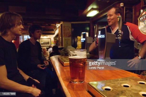 Customers at bar, Jolly Judge pub.
