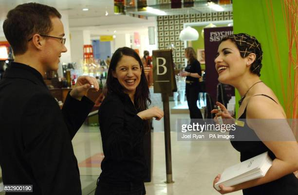 Customers at Selfridges store in west London tests the scentless Choix 'perfume' priced at 30 per bottle