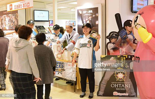 Customers at Takashimaya Co department store in the western Japan city of Osaka line up to receive packs of ham on Nov 21 during an event to...