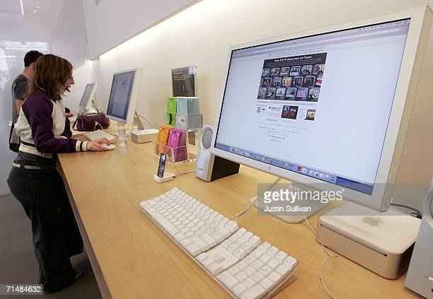 Customers at the Apple Store try out Mac desktop computers July 19 2006 in San Francisco California Apple Computer Inc announced that third quarter...