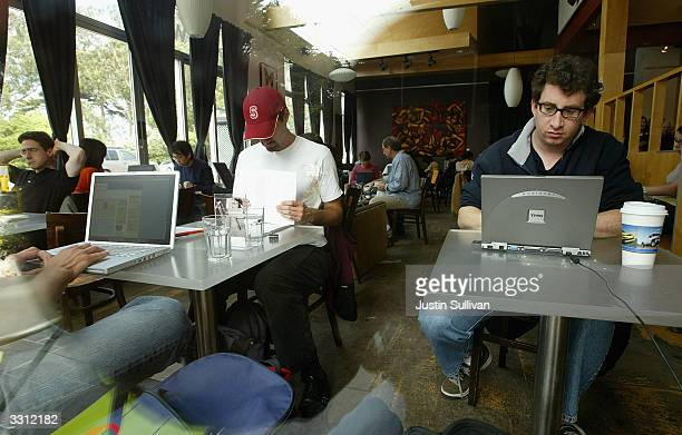 Customers at the Canvas Cafe take advantage of free wireless 'wifi' internet access April 9 2004 in San Francisco According to a new study sponsored...