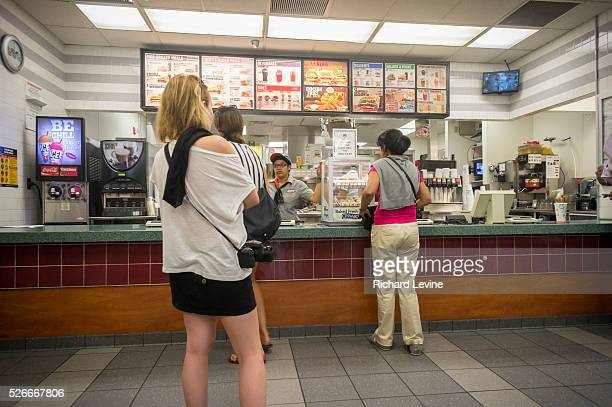 Customers at the counter of a Burger King fast food restaurant in New York on Monday August 25 2014 Restaurant Brands International the parent of...
