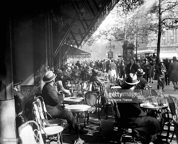 Customers at the terrace of the Cafe de la Paix circa 1920 in Paris France
