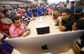 Customers attend a workshop in Brazil's first Apple retail store after it opened to the public for the first time in the Village Mall shopping center...