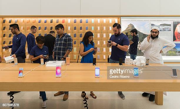 Customers attend the Apple iPhone 7 launch at Mall of the Emirates on September 17 2016 in Dubai United Arab Emirates
