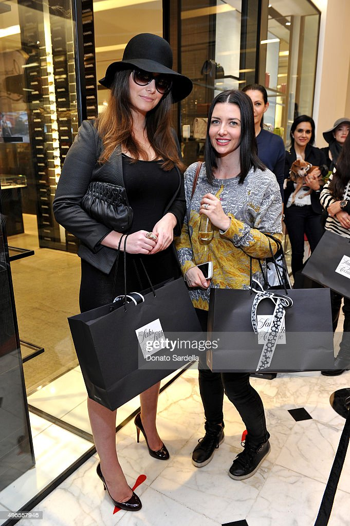 Customers attend the Christian Louboutin personal appearance and shoe signing at Saks Fifth Avenue Beverly Hills on November 10, 2015 in Beverly Hills, California.