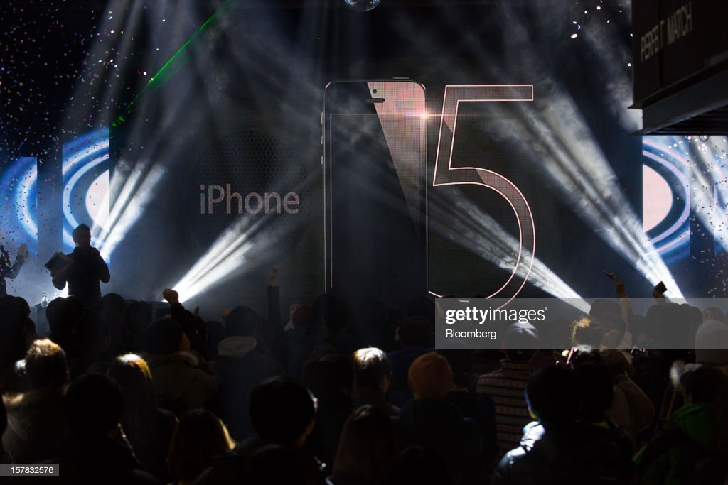 Customers await the sales launch of the Apple Inc. iPhone 5 during an event organized by SK Telecom Co. in Seoul, South Korea, on Thursday, Dec. 6, 2012. The iPhone 5 went on sale in South Korea today. Photographer: SeongJoon Cho/Bloomberg via Getty Images