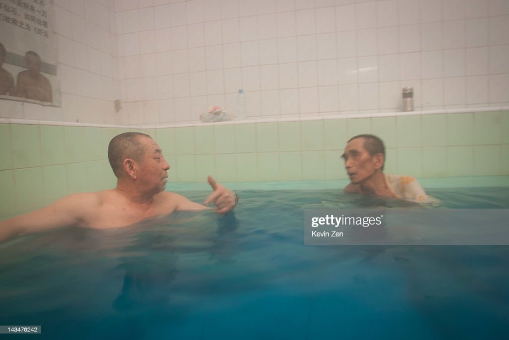 Customers bathe at Shuangxing Tang Bathhouse on December 8, 2011 in Beijing, China. The Shuangxing Tang Bathhouse is the last remaining public bathhouse in Beijing and faces demolition as the area undergoes development. Opened on 1916, the bathhouse provides its patrons with a culture that is dying out, offering traditional treatments and massages it stands as a relic of the old Beijing, but with ever-decreasing water resources its future remains uncertain.