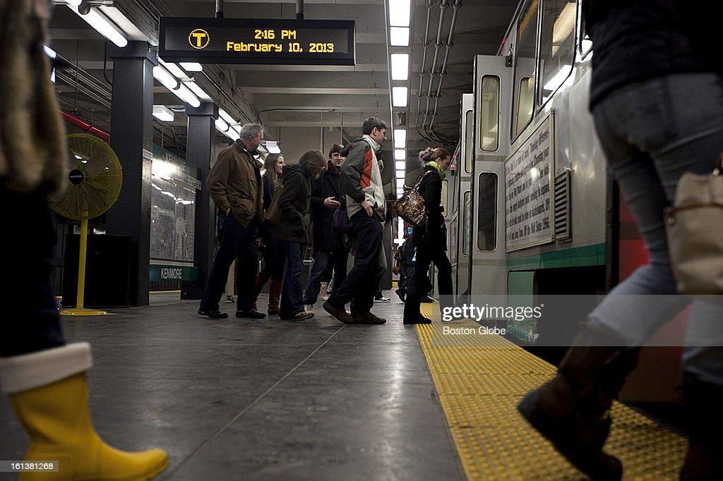 Customers boarded a green line T at Kenmore Square in Boston, MA on Sunday, February 10, 2013. The MBTA announced it would resume limited service at 2 p.m.